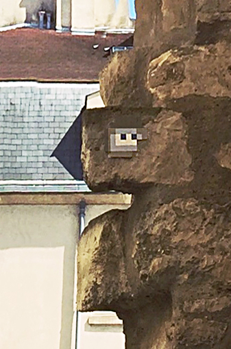 Our first Invader was camouflaged on a 12th-century wall (Wall of Philip Augustus), and we nearly walked right past it.