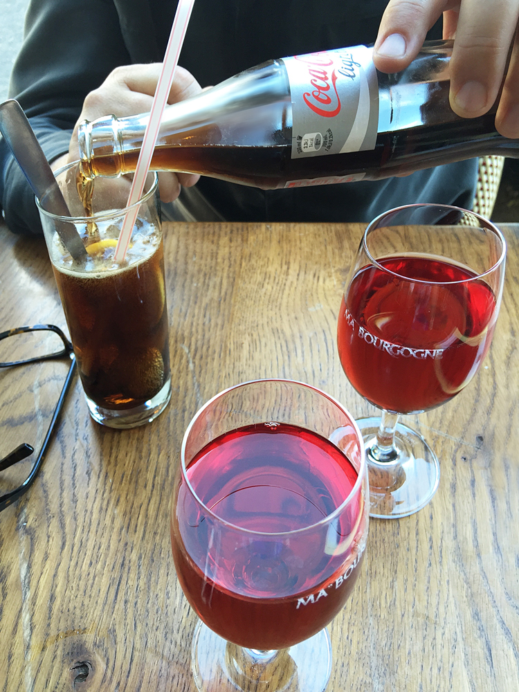 #1) To enjoy a kir at Andy's mom's favorite place for the apéritif.